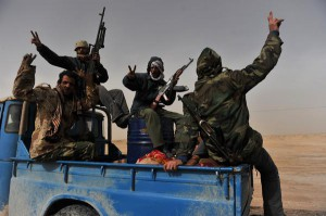"Libyan rebel fighters flash the ""victory"