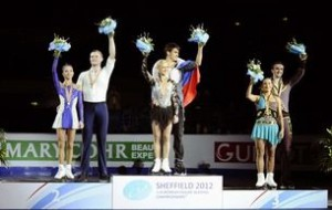Volosozhar and Trankov of Russia react after winning the pairs free skating programme at the European Figure Skating Championships in Sheffield