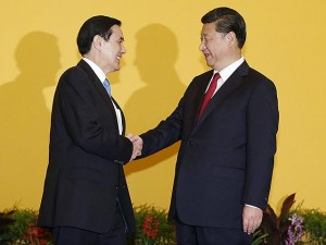 China's President Xi Jinping shakes hands with Taiwan's President Ma Ying‎-jeou during a summit in Singapore