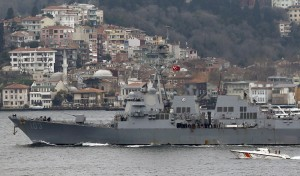 U.S. Navy guided-missile destroyer USS Truxtun is escorted by a Turkish Navy Coast Guard boat as it sets sail in the Bosphorus, on its way to the Black Sea