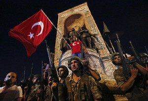 Turkish military stand in front of the Republic Monument at the Taksim Square in Istanbul