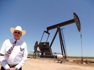 TO GO WITH AFP STORY: Commodities-oil-energy-price-US-boom-crime by Mira Oberman. This June 18, 2008 photo shows Midland County Sheriff Gary Painter standing next to a pump jack outside of Midland, Texas. The wide open oilfields of West Texas are ripe pickings for thieves these days. Some drive up to one of the thousands of pump jacks that dot the countryside and siphon crude out of the storage tanks. Some pull up to a drill site after the crews have gone for the night and haul away tools, pipes and equipment. Others take kickbacks, file false invoices or just plain steal knowing their bosses are too busy riding the oil boom to keep a close eye on accounting. AFP PHOTO/COR (Photo credit should read MIRA OBERMAN/AFP/Getty Images)