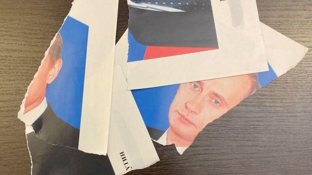 В Петербурге полицейских вызвали в муниципалитет из-за порванного портрета Путина