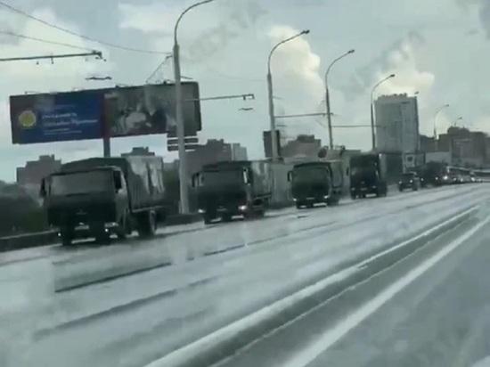 В центр Минска перед акцией оппозиции стягивают силовиков и военную технику